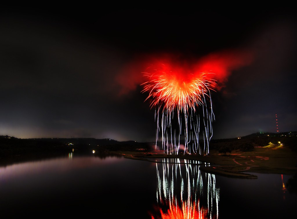 Heart of Satan - What it looks like when fireworks explode inside of a storm cloud over a river