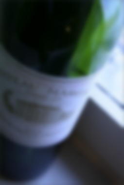 Blurred bottle of wine