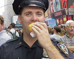 Cop Eats Doughnut! (PLCjr) Tags: nyc police timessquare donut doughnut cop dunkindonut