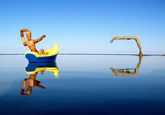 woody spots danger (sandcastlematt) Tags: sculpture reflection castle beach toys boat sand massachusetts woody sandcastle sandsculpture toyboat sandhand bostonist duxbury duxburybeach universalhub adventuresofwoody submergedsandmonster