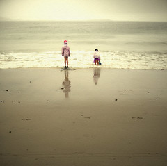 a scene at the sea (hanna.bi) Tags: autumn ireland sea cold beach children landscape play cloudy achillisland comayo blueribbonwinner hannabi 25faves keemstrand