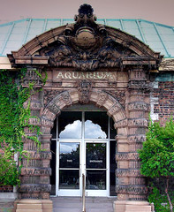 Abandoned Aquarium Building at Belle Isle in Detroit (DetroitDerek Photography ( ALL RIGHTS RESERVED )) Tags: door summer usa fish building brick history abandoned sign swim zoo aquarium closed michigan empty detroit entrance structure historic kahn vacant oldest belleisle detroitzoo 2007 speakeasy motown motorcity