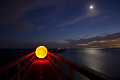 Welcome Home (TTYL8R) Tags: sunset moon lightpainting night stars pier bright orb leds lightart lapp matagordabay lightartperformancephotography