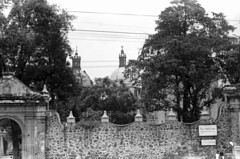 0710b70 17 33B (ndpa / s. lundeen, archivist) Tags: trees blackandwhite bw church monochrome architecture fence mexico blackwhite gate cross nick july steeple spire mexican dome mission 1970 1970s dewolf nickdewolf photographbynickdewolf