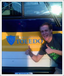Dave Poses by UT Bus