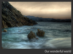 Our wonderful world (caese) Tags: ocean longexposure sea mer nature water sunrise coast nikon rocks eau cte galicia shore hdr rochers ocan naturesfinest photomatix laxe outstandingshots platinumphoto superbmasterpiece goldenphotographer diamondclassphotographer flickrdiamond d40x excellentphotographerawards theperfectphotographer caese