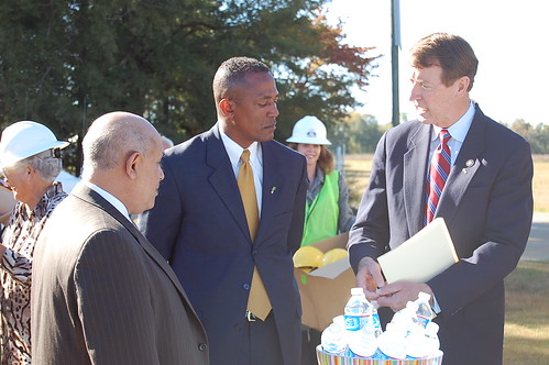 Deputy Under Secretary Vasquez, State Director Randall Gore, Congressman Bob Etheridge discussing the school project
