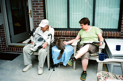 Billy O, Domino, Bob, and Maggie on the patio (Michael Berch) Tags: leica dog film cat nebraska bob maggie lincoln domino m6 leicam6 pantscentral billyo ektar100 jupiter850mmf20