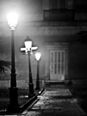 El oscuro camino de farolas torcidas (Pedro Herrero) Tags: street light bw white black blancoynegro blanco luz lamp night 50mm noche calle alone loneliness camino path negro olympus bn torch lamppost solo soledad om 18 zuiko e520