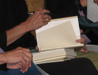 Writer's Hands, Mary Oliver's hands, signing a copy of Thirst, May 2007, Minneapolis, Minnesota, photo © 2007 by QuoinMonkey. All rights reserved.