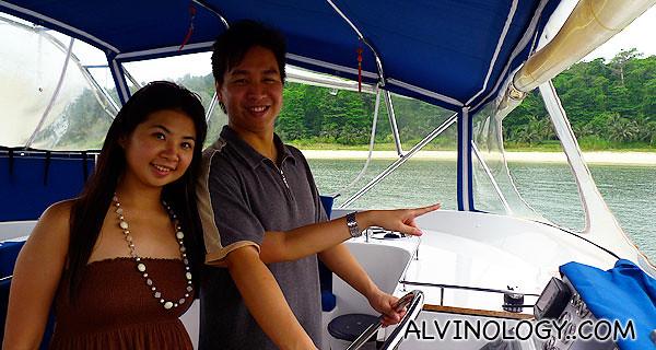 Mark and Meiyen pretending to steer the yacht