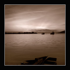 Sanctuary of Stillness (Jeremy-G) Tags: wood sea sky mountain water sepia canon evening boat bravo searchthebest jetty horizon rays riverbank stillness magicdonkey 400d anawesomeshot superaplus aplusphoto blueribbonphotography superbmasterpiece goldenphotographer