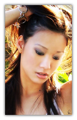Steph 16 (tishay) Tags: portrait woman girl closeup female hair photography saturated backyard steph portraiture crossprocessing femaleportrait fujifilmfinepixs5100 challengeyouwinner