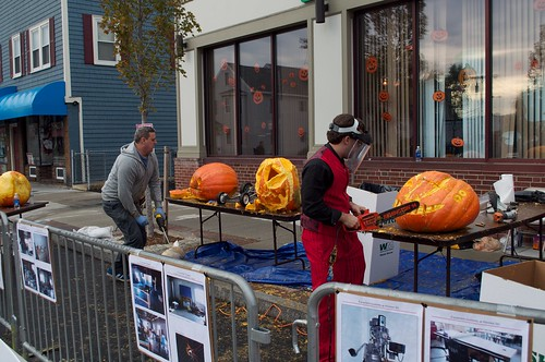 Hilljack and Gui carve pumpkins with a sawzall and chainsaw.