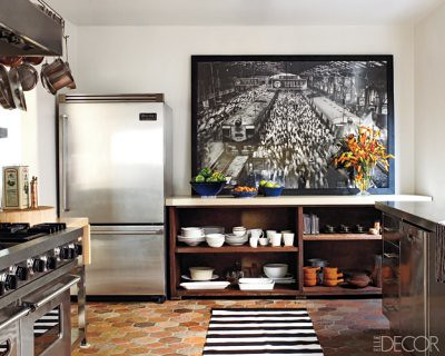 Ellen Pompeo's black + white kitchen: Terra cotta tile + striped rug + oversized photo
