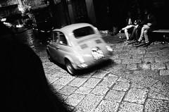 ... (icomewhenieatcaponata) Tags: italien november girls people bw italy film car rain analog cn 35mm canon vintage eos blurry fiat market kodak running 400 sicily taverna maggiore 300 500 raining palermo sicilia   azzurra sizilien vucciria           peppopeppo  puddicinu