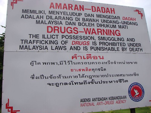 Drugs are punishable by death! Malaysia border sign post.