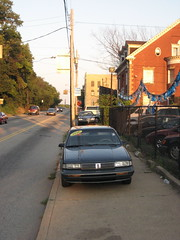 cars parked on sidewalk 2