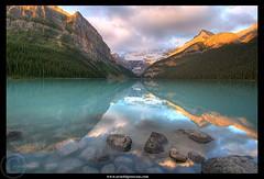 Lake Louise by Sunrise (Arnold Pouteau's) Tags: canada reflection sunrise rockymountains lakelouise banffnationalpark naturesfinest diamondclassphotographer flickrdiamond arnoldpouteau naturewatcher fland10