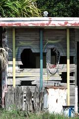 Weathered (Carla Finley) Tags: wood net bucket graffitti waterheater oldbuilding tar