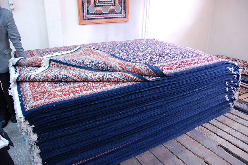 A Pile of Hereke Tree of Life Design Carpets