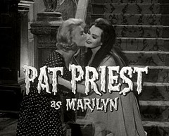 Pat Priest kisses Yvonne DeCarlo on 'The Munsters'