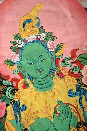 Face detail - Green Tara thangka, the savior, Tibetan style painting (with Nepalese style headress), Seattle, Washington, USA by Wonderlane