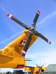 canadian rescue helicopter (axiepics) Tags: rescue canada helicopter airbase propeller cfb comox interestingness152 c y r p four 4 challengeyouwinner cywinner theworldthroughmyeyes karma yellow blue red challengeyou gameswinner 1gw explore interestingness exploreinterestingness explored i500 highestposition152onfridayjune222007 flying planes aeronautics copyrightalexskellyallrightsreserved