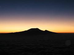 Kilimanjaro dawn (tik_tok) Tags: africa travel sun mountain kilimanjaro silhouette digital sunrise canon landscape geotagged tanzania volcano a520 peak hike powershot climbing rise arusha 2007 canonpowershot meru mountmeru elevation55006000m mountainskilimanjaro summitkibo altitude5985m