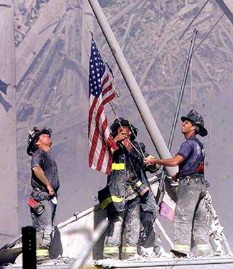 American Flag in front of World Trade Center ruins