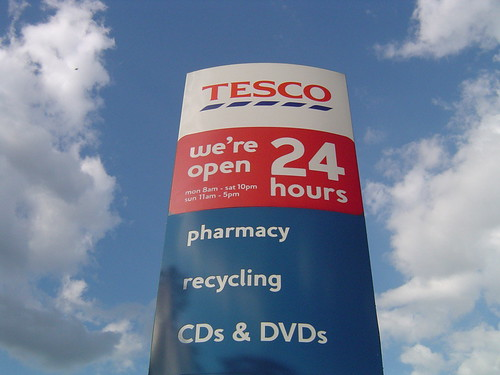 Tesco supermarket sign: We're open 24 hours