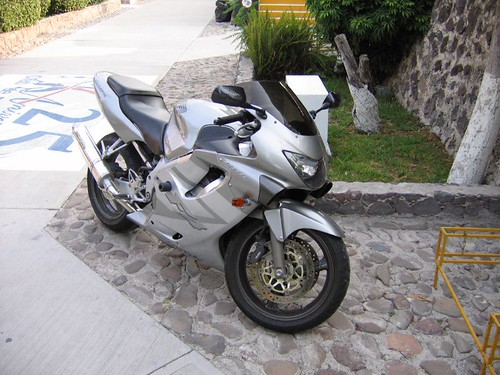 A silver Honda CBR600 parked in a driveway