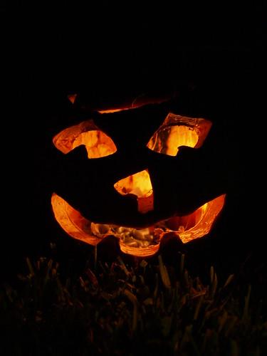 Halloween pumpkin or jack o lantern 2010 monstrous face light illuminated