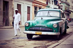 Motion/less (theGentleman) Tags: street old family baby white green car america nikon child d70 photos pavement rustic havana cuba central plymouth 2006 cheeky cap parked aged nikkor passerby stationary 1224 rundown thegentleman lookinh cheekyphotoscouk