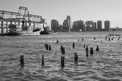 Wharf remnants, Hudson River NYC (Luke Redmond) Tags: old nyc bw water boat photo newjersey wharf hudsonriver tug pylons remnant wharves photographerlukeredmond