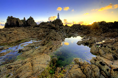 Rocky landscape at Corbiere (Corica) Tags: uk greatbritain sunset clouds photoshop rocks pools jersey hdr channelislands rockpools corbiere sigma1020mm photomatix corica corbierelighthouse canon400d aplusphoto