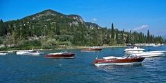 Riva motorboats' parade (faxao) Tags: boats garda sailing riva barche vela ishares centomiglia extreme40