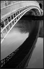 H'penny Bridge (Stuart Pearson Photography) Tags: city bridge ireland dublin monochrome architecture river blackwhite aperture nikon nef transport 2870mmf3545d jpeg hapennybridge riverliffey views100 d80 themereflection afnikkor2870mmf3545dmacrozoom