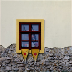the window with the split personality (fourcotts) Tags: wood blue white window glass yellow stone wall square grey plaster flags frame slovakia bratislava divided pennants 500x500 bsquare superaplus aplusphoto fourcotts