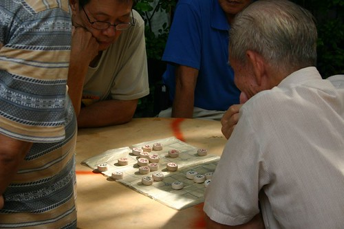 Elders playing Chinese chess in Chinatown, Singapore.