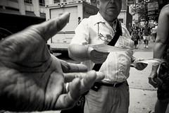 HANDOFF (joewig) Tags: city nyc people bw blackwhite interestingness streetphotography 7thwave ricohgrdigitaliii