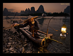 When Time Stood Still - II (Ragstatic) Tags: world life china old travel light sunset people fish man heritage feet nature relax still fishing hands nikon rocks exposure glow view time earth stones guilin rags yangshuo quality culture surreal scene bamboo shore balance cormorant raft lantern ng publication nationalgeographic subtle guangxi lifescape xingping singleexposure d700