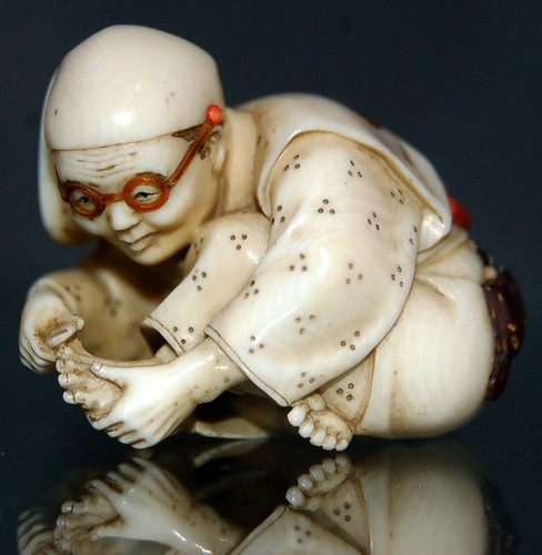 Man clipping toenails Netsuke