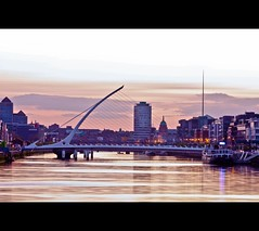 Dublin at Dusk (Mick H 51) Tags: bridge ireland sunset dublin reflection skyline canon river eos boat dusk spire liffey ifsc calatrava docklands beckett quays samuel santiagocalatrava cillairne spencerdock 450d airne 55250 thecustomhouse smauel 94112 mvcillairne thesamuelbeckettbridge
