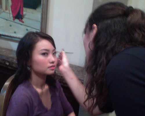 Make-up artist working on Grace