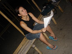 reading a script on location for Living Asia Channel