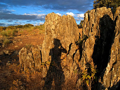 Sombras en las rocas (guadags) Tags: sunset portrait sky yellow stone clouds atardecer spain shadows sombra reflect roca monroy extremadura olimpus supershot