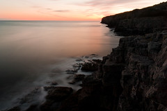 Winspit Cove, Dorset (flatworldsedge) Tags: longexposure sunset sea england orange clouds coast surf waves peach cliffs atlantic dorset crags jurassic headland explored