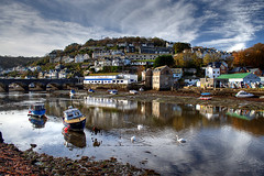 Sleepy autumn day in Looe (rosyrosie2009) Tags: uk bridge sea england seascape water clouds port reflections river landscape boats photography coast nikon flickr cornwall photos explore lowtide hdr gettyimages looe westcountry coastpath photomatix tonemapped nikkor1855mm explored devonandcornwall looebay d5000 rosiesphotos nikkor1855mmf3556vr nikkor1855mmf3556gvr nikond5000 looebridge rosiespooner rosyrosie2009 rosemaryspooner rosiespoonerphotography