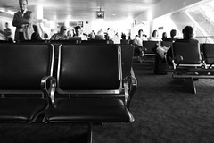 So many different people, so many different lives... (anita gt) Tags: bw usa airport chair miami bn silla aeropuerto utatafeature utata:project=justblack